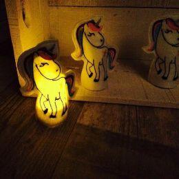 Leuchtende Einhörner